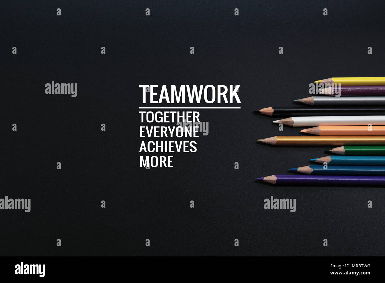 Teamwork concept. group of color pencil on black background with word Teamwork, Together, Everyone, Achieves and More - Stock Image