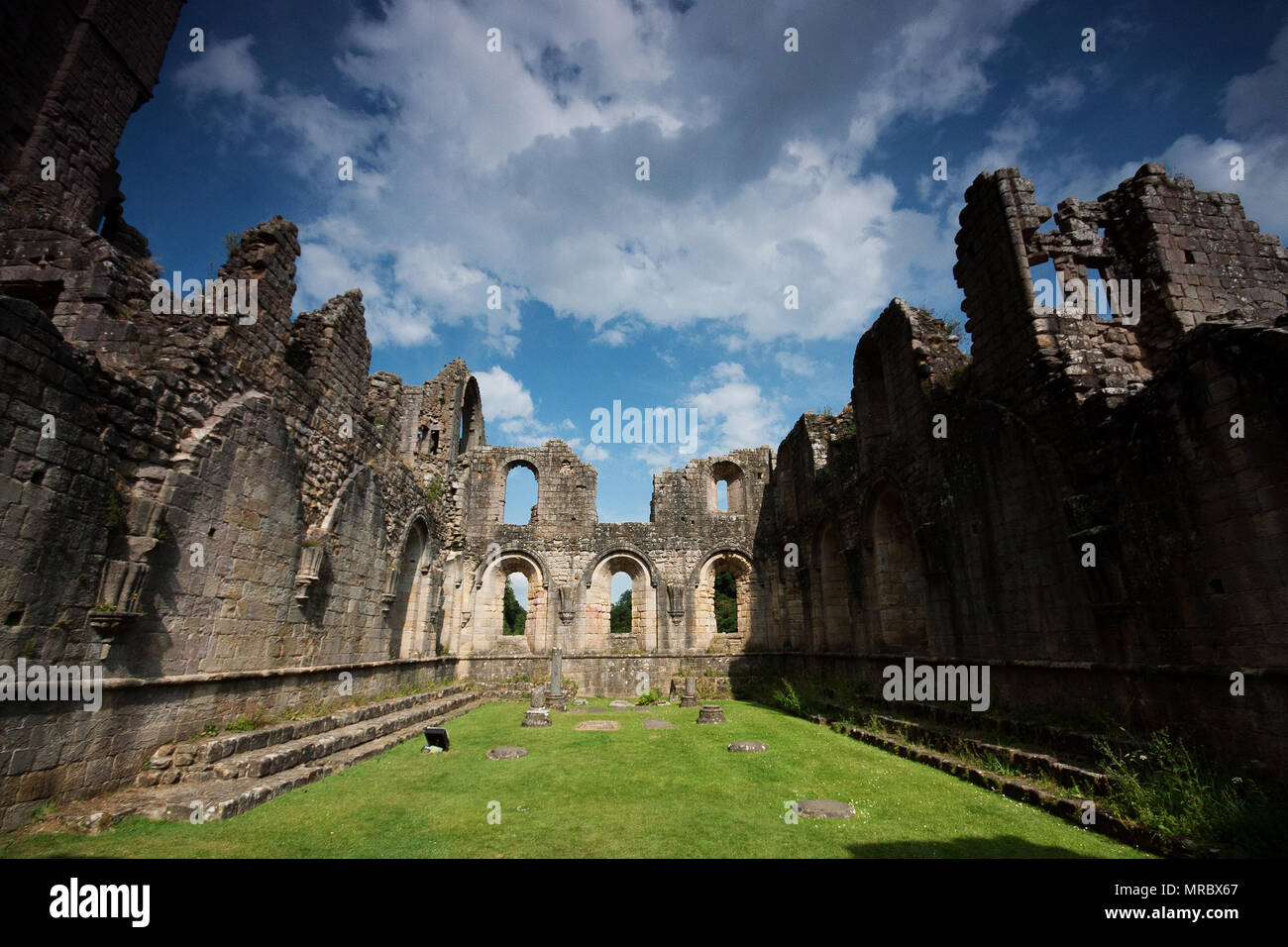 Courtyard-like interior of the monastery ruins in Fountains Abbey, Ripon, UK - Stock Image