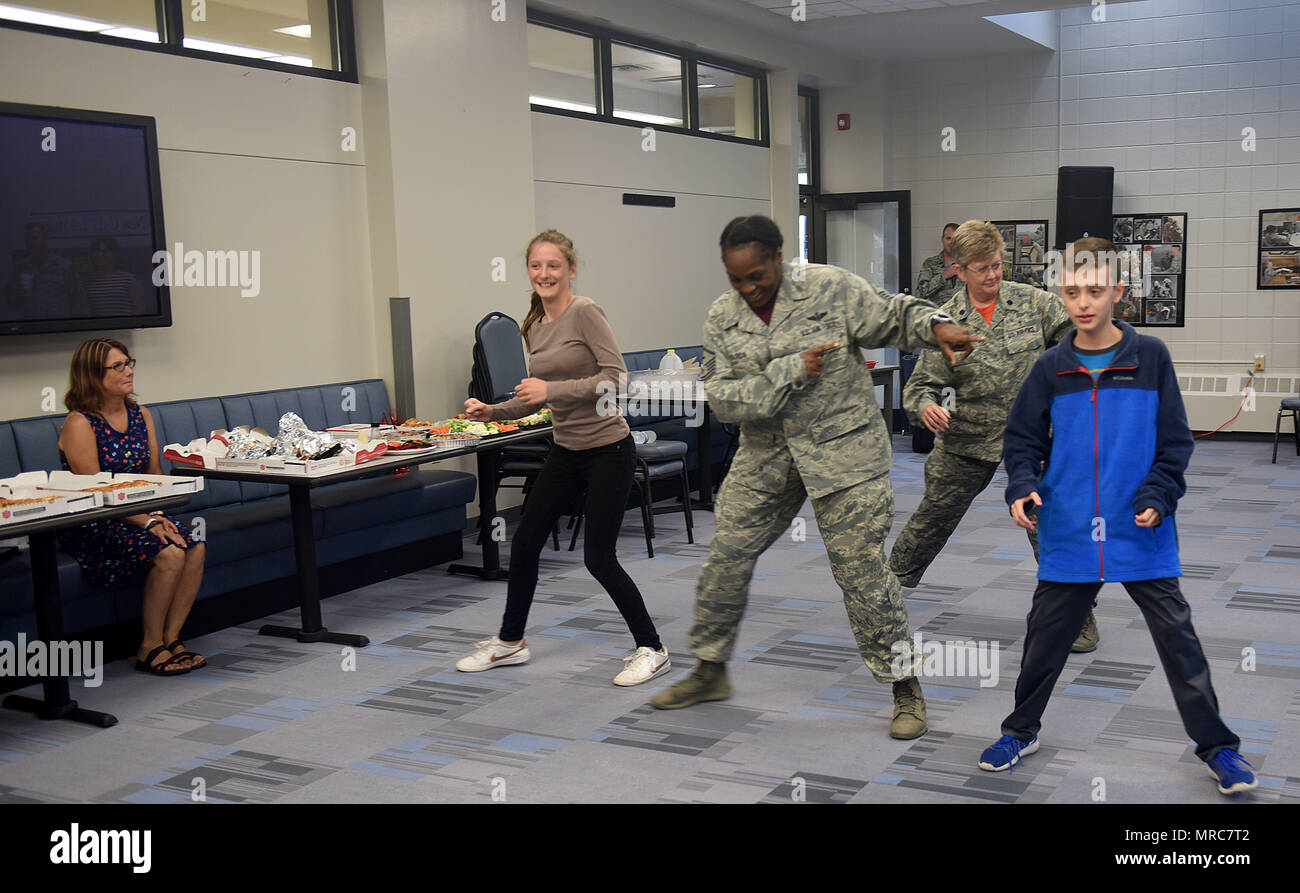 Friends and family of the North Carolina Air National Guard hit the dance floor during a family event held at the North Carolina Air National Guard Base, Charlotte Douglas International Airport, June 3, 2017. The event, organized by Chaplain Debra Kidd, allowed time to honor family of deployed members with dancing, dining, crafts, and more. (U.S. Air National Guard photo by Staff. Sgt. Laura J. Montgomery) - Stock Image
