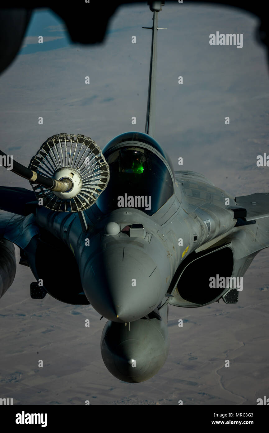 A French Naval Rafale receives fuel from a 908th Expeditionary Air Refueling Squadron KC-10 Extender during a flight in support of Operation Inherent Resolve June 2, 2017. Rafale is a French twin-engine, canard delta wing, multirole fighter aircraft with a wide range of weapons. The Rafale is intended to perform air supremacy, interdiction, aerial reconnaissance, ground support, in-depth strike and anti-ship strike missions. (U.S. Air Force photo by Staff Sgt. Michael Battles) - Stock Image