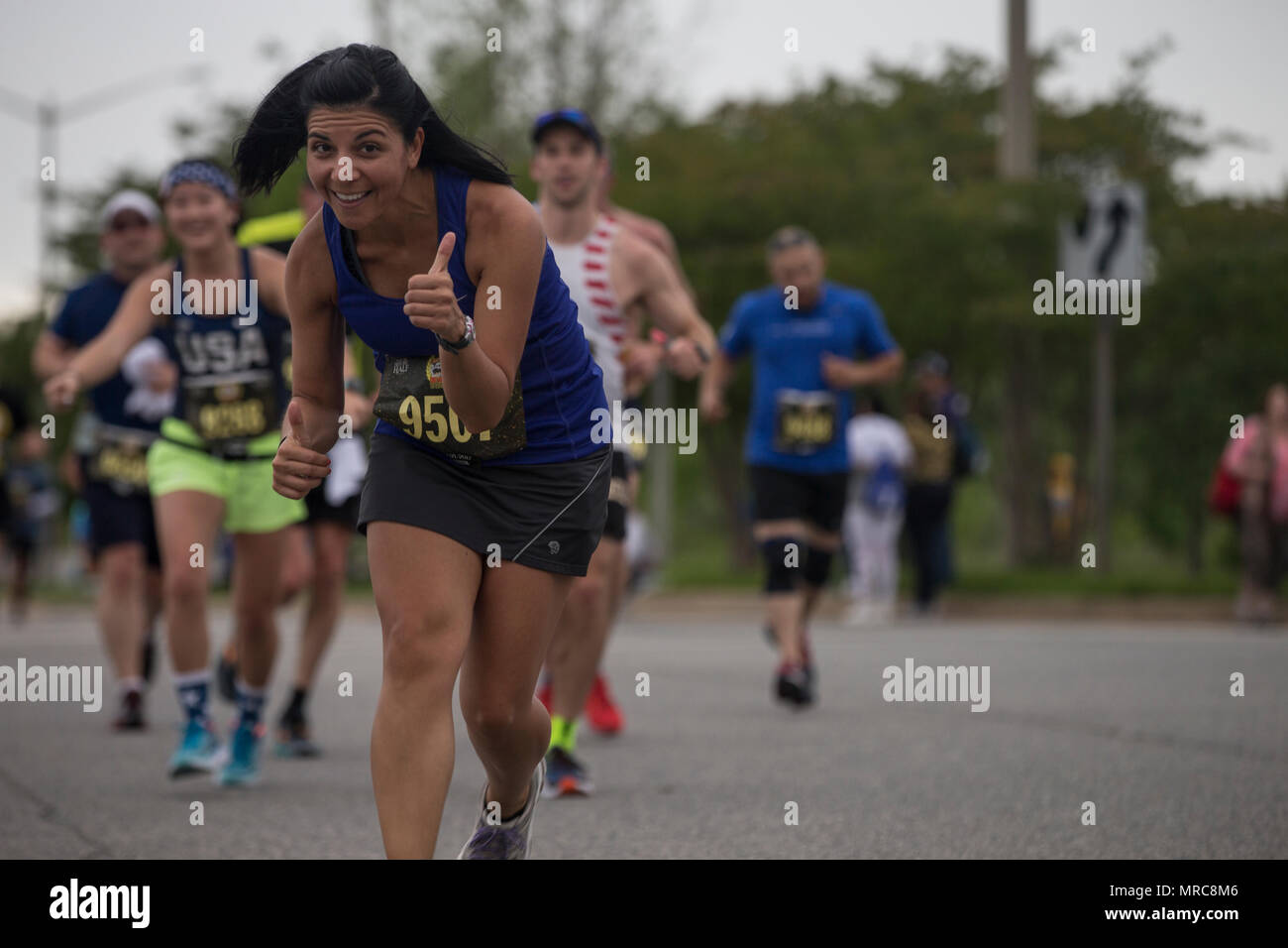 Brenna Cliver poses while running the Devil Dog Double, part of the 10th Annual Marine Corps Historic Half, (MCHH) Fredericksburg, Va., May 21, 2017. The MCHH attracts over 8,000 participants and features the Marine Corps Semper 5ive and the Devil Dog Double. (U.S. Marine Corps photo by Sgt. John M. Raufmann) Stock Photo