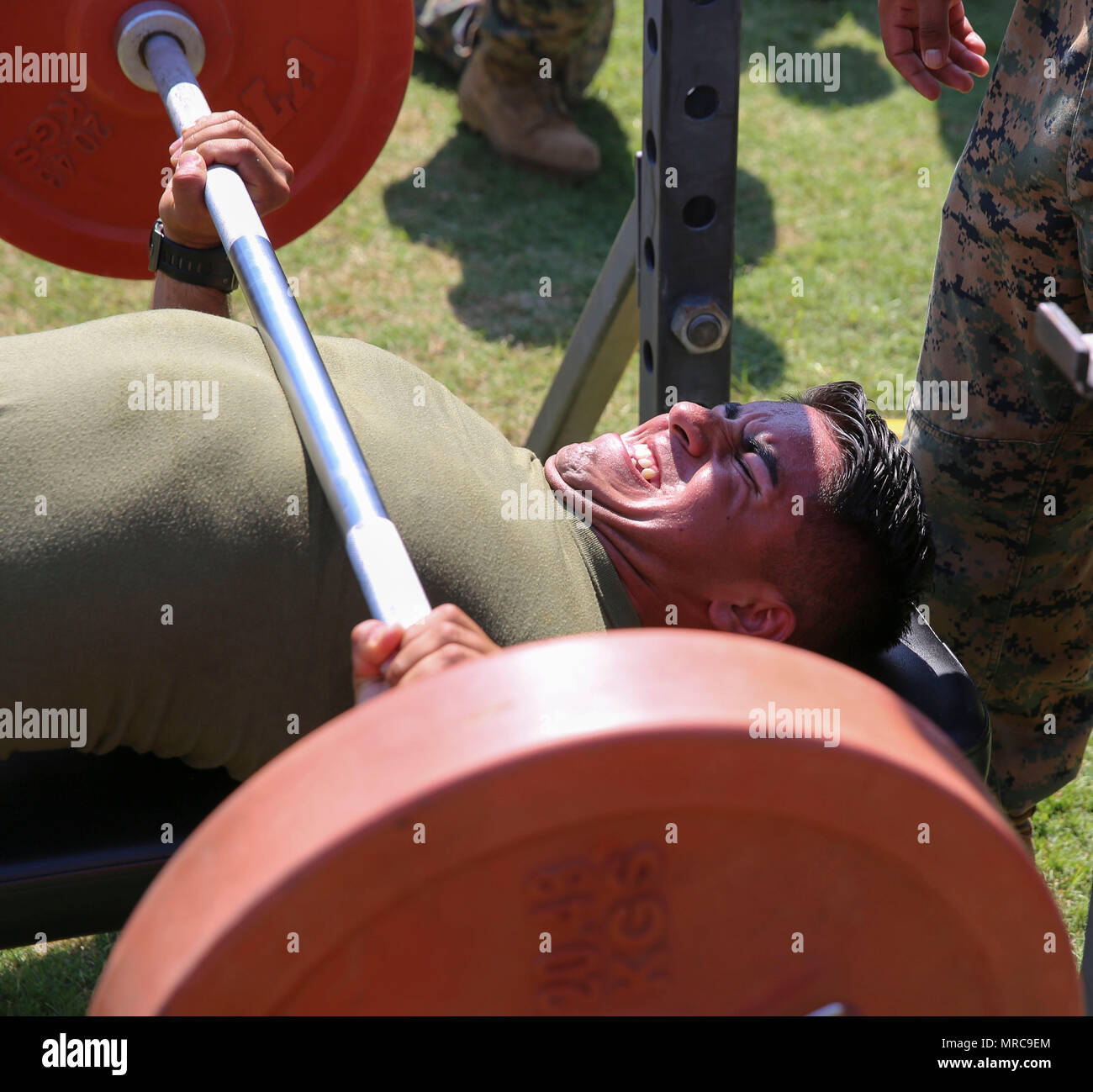 Cpl. Bryant Morillon competes in the bench press competition during a combine hosted by Marine Air Control Group 28 at Marine Corps Air Station Cherry Point, N.C., June 2, 2017.  Teams of 20 Marines from each squadron within the control group competed in multiple events which included a Humvee push, javelin throw and tire flip competition. Morillon is a warehouse clerk assigned to Marine Air Support Squadron 1, MACG-28, 2nd Marine Aircraft Wing. (U.S. Marine Corps photo by Lance Cpl. Cody Lemons/Released) Stock Photo