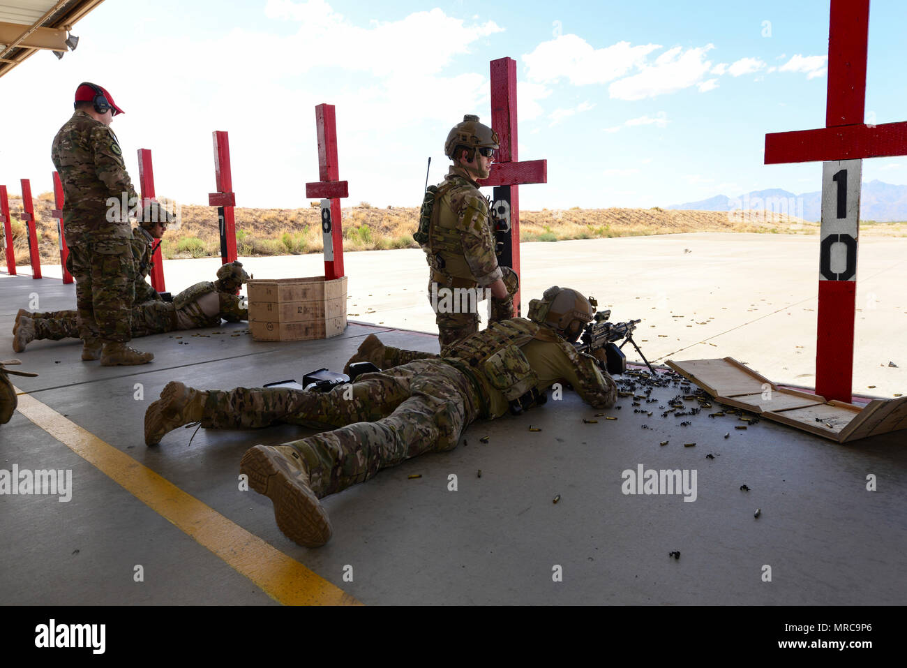 U.S. Air Force pararescuemen fire M249 automatic rifles during the Guardian Angel Mission Qualification Training course at Davis-Monthan Air Force Base, Ariz., May 18, 2017. The MQT is a 90 day course that takes pararescuemen who have completed Air Education and Training Command schooling and helps them achieve their 5-level qualification. (U.S. Air Force photo by Airman 1st Class Nathan H. Barbour) - Stock Image