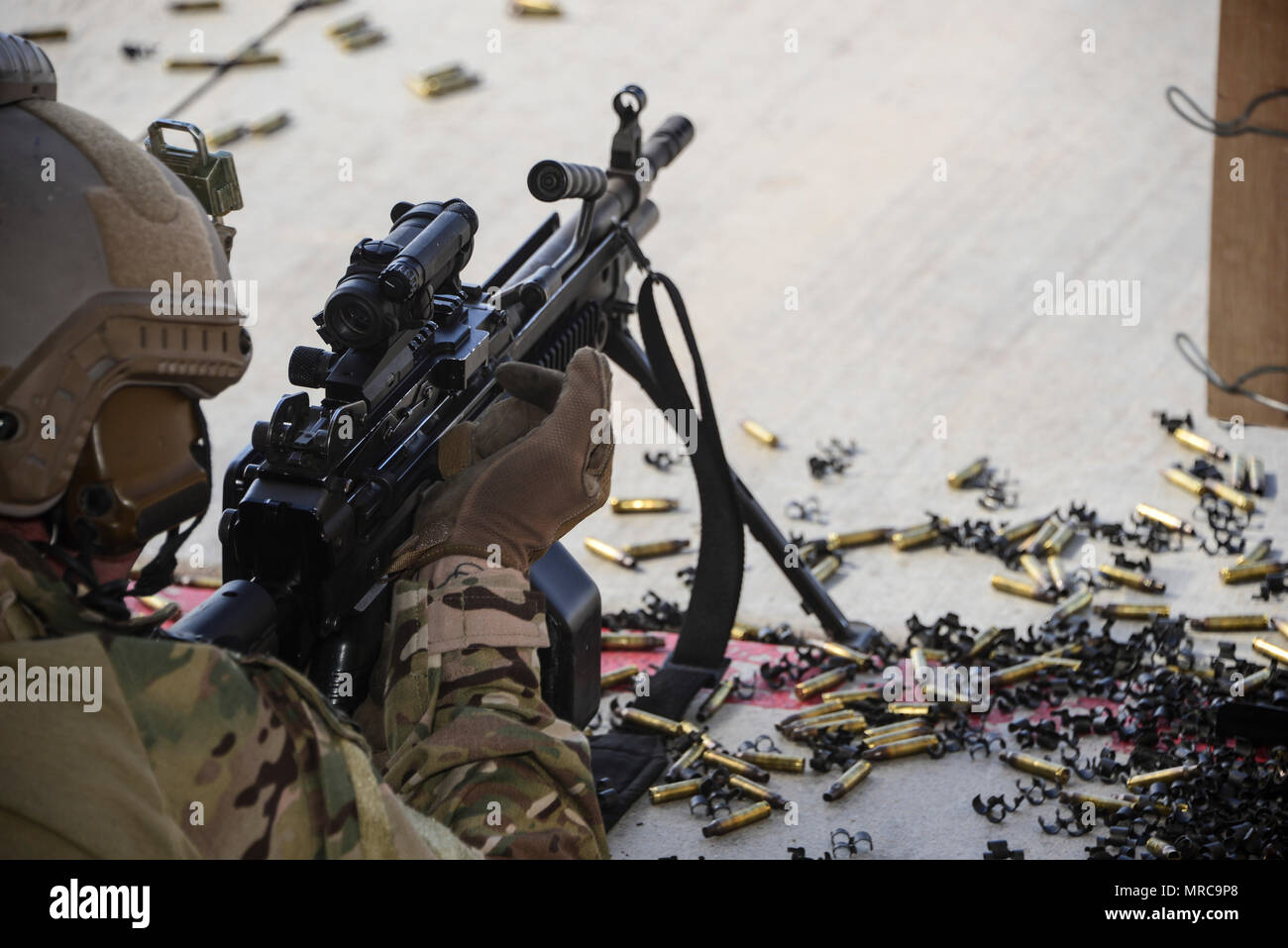 A U.S. Air Force pararescueman fires an M249 automatic rifle during the Guardian Angel Mission Qualification Training course at Davis-Monthan Air Force Base, Ariz., May 18, 2017. The MQT is a 90 day course that takes pararescuemen who have completed Air Education and Training Command schooling and helps them achieve their 5-level qualification. (U.S. Air Force photo by Airman 1st Class Nathan H. Barbour) - Stock Image