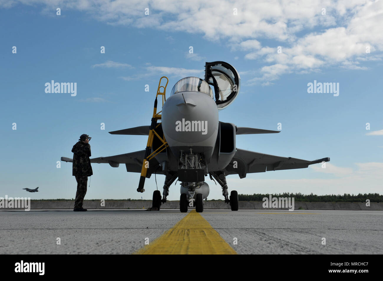 A Hungarian JAS 39 Gripen prepares to taxi as an F-16