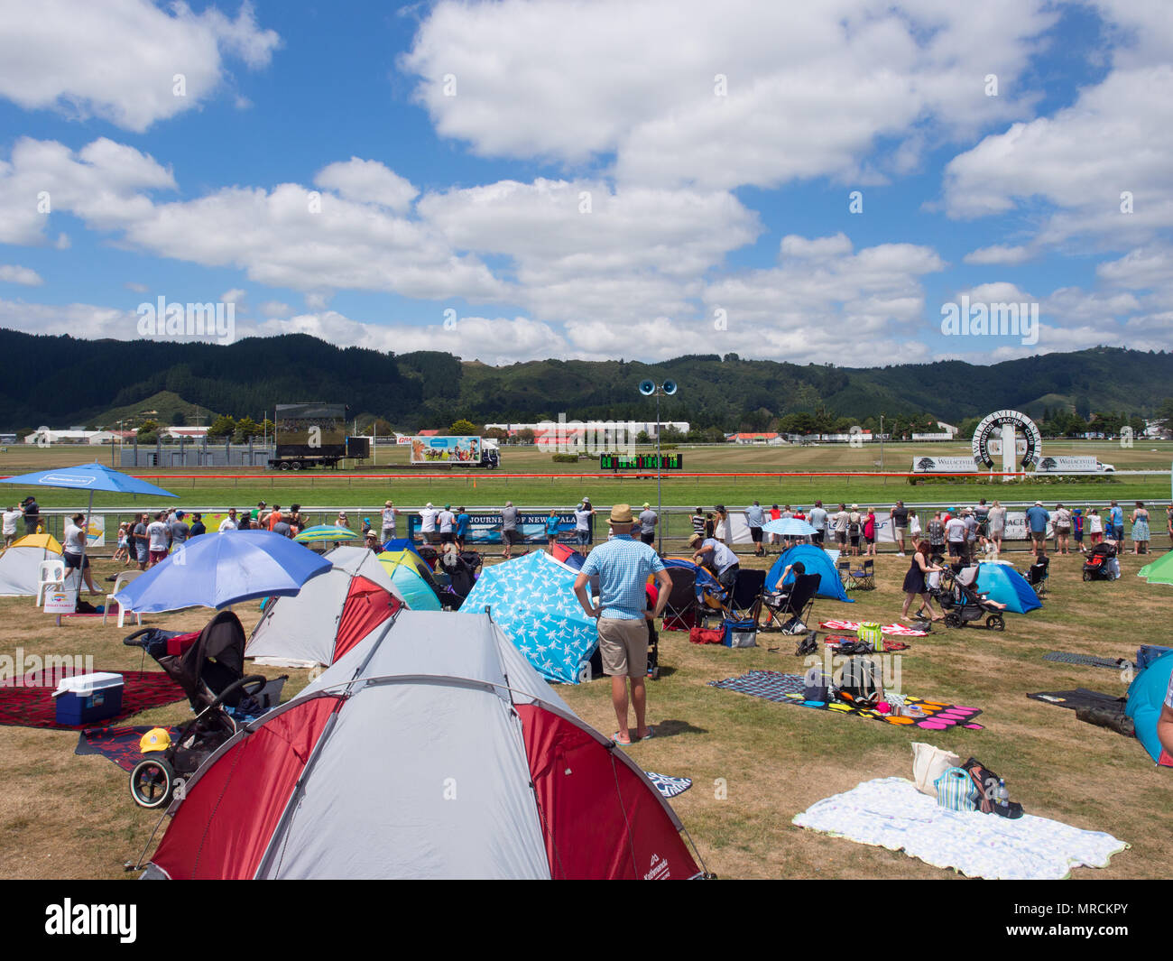 Crowd Of People At The Races At Trentham Racecourse - Stock Image