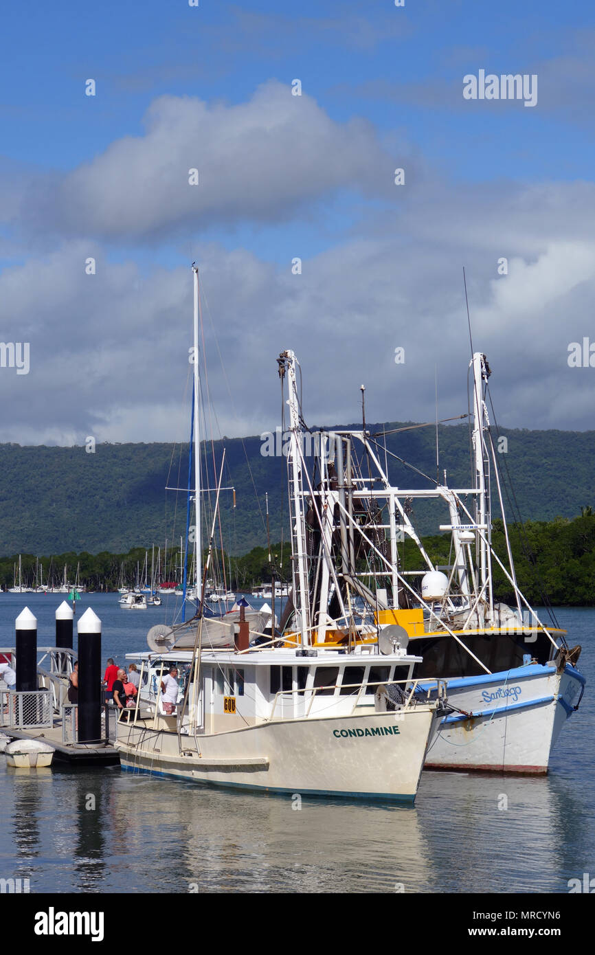 Fishing trawlers Condamine and Santiego selling fresh fish and prawns to the public at the wharf, Port Douglas, Queensland, Australia. NO MR or PR - Stock Image