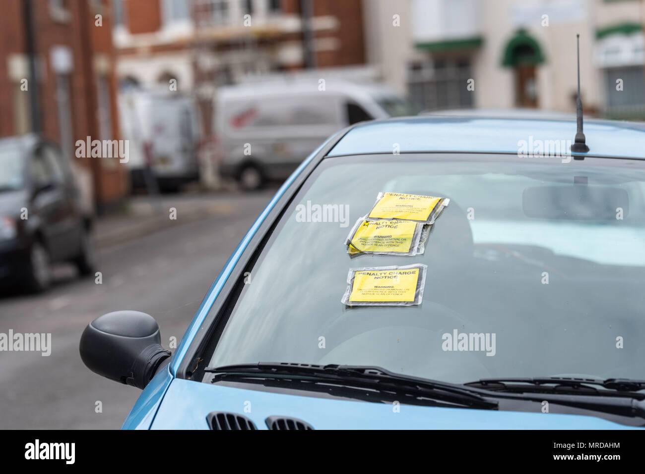 Penalty Charge Notice on Car Windscreen parked on British road in England. - Stock Image