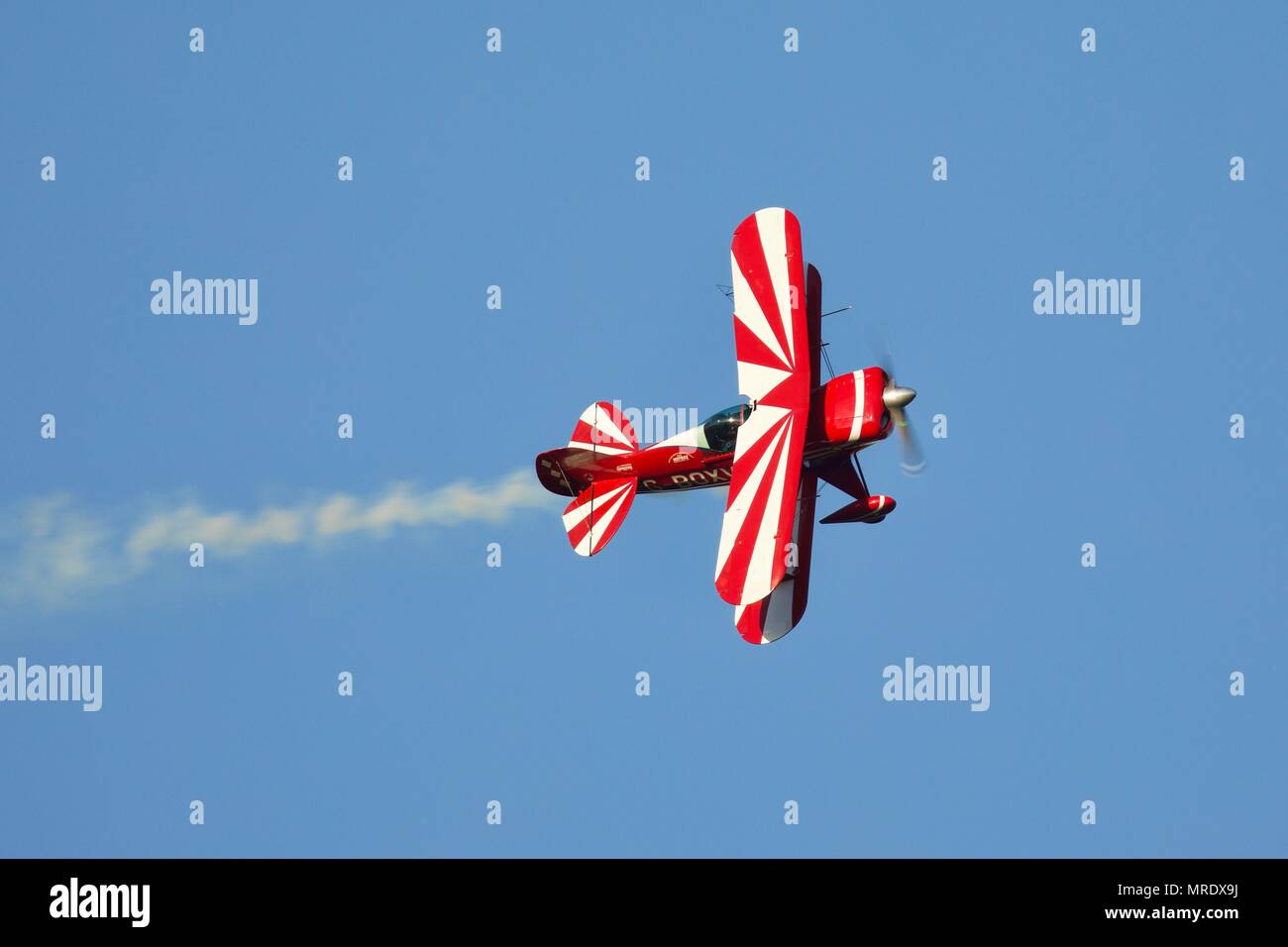 Pitts Special Aerobatic Biplane Performing A Fast And Exciting
