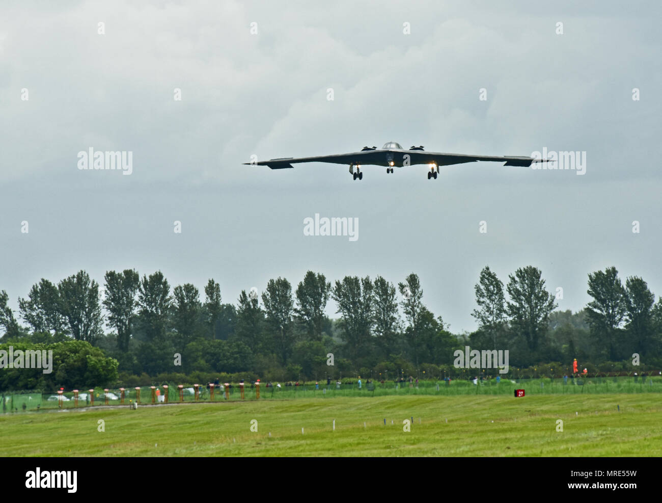 A B-2 Spirit deployed from Whiteman Air Force Base, Mo., approaches the runway at RAF Fairford, U.K., June 9, 2017. The B-2 routinely conducts bomber assurance and deterrence missions providing a flexible and vigilant long-range global strike capability, and is just one demonstration of the U.S. commitment to supporting global security. (U.S. Air Force photo by Tech. Sgt. Miguel Lara III) Stock Photo