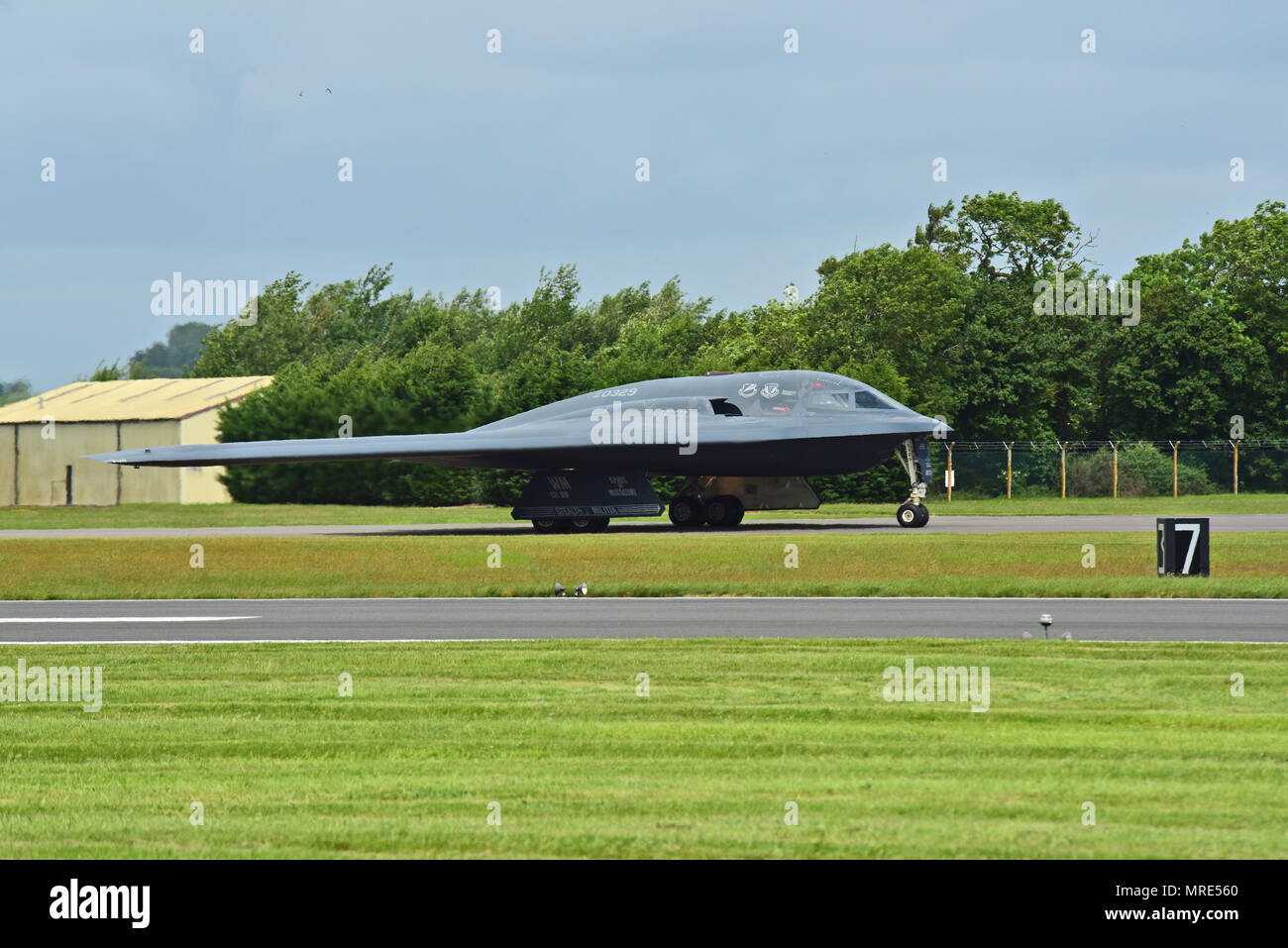 A B-2 Spirt deployed from Whiteman Air Force Base, Mo., approaches the runway at RAF Fairford, U.K., June 9, 2017. The B-2 routinely conducts bomber assurance and deterrence missions providing a flexible and vigilant long-range global strike capability, and is just one demonstration of the U.S. commitment to supporting global security. (U.S. Air Force photo by Tech. Sgt. Miguel Lara III) Stock Photo