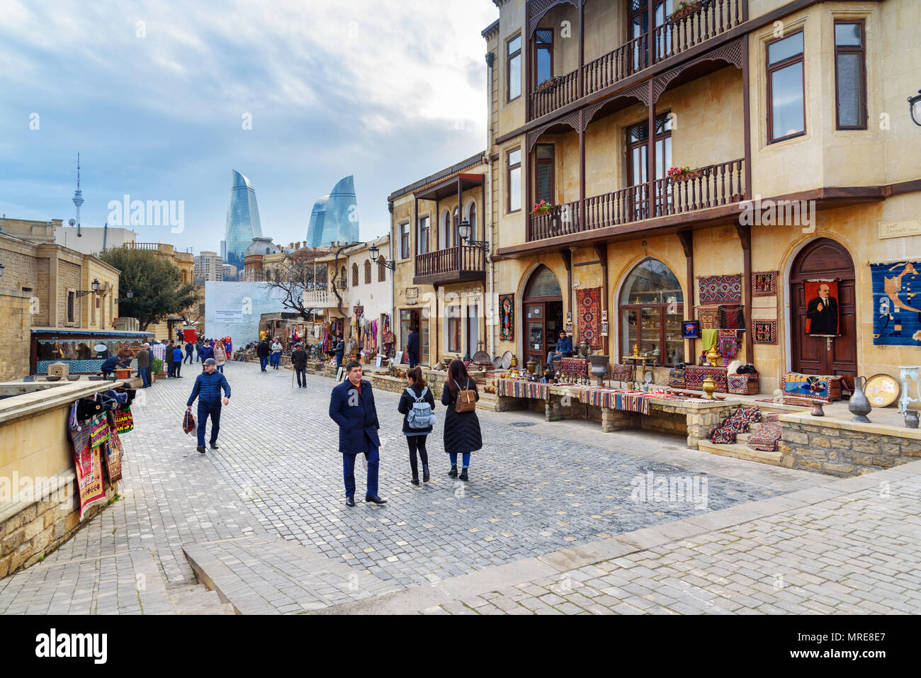 Baku, Azerbaijan - March 10, 2018: Street in Old city,Icheri Sheher is the historical core of Baku. And view of Flame Towers - Stock Image