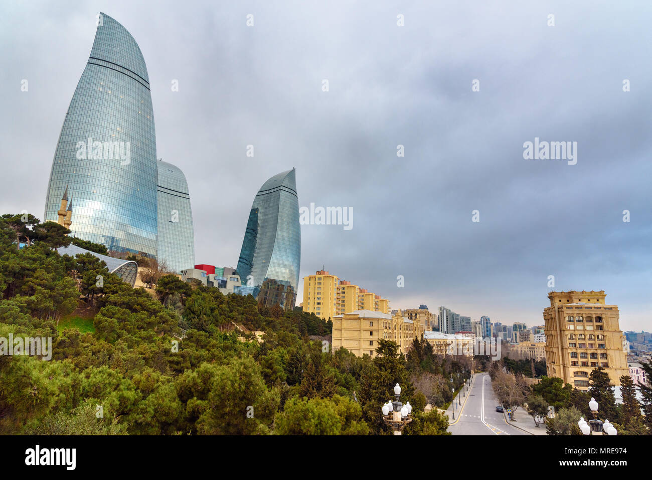 Baku, Azerbaijan - March 11, 2018: View of Flame Towers from Upland park in the evening - Stock Image