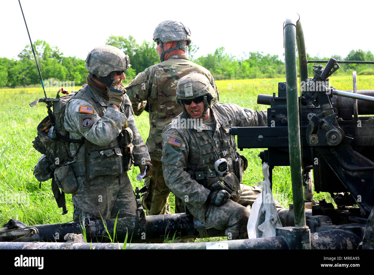 New York Army National Guard Soldiers assigned to Alpha Battery, 1st Battalion, 258th Artillery Regiment, 27th Infantry Brigade Combat Team prepares to fire an M119A2 105mm Howitzer during an air assault artillery raid at Fort Drum on June 9, 2017. During the raid, 4 of the battery's cannons were transported to a landing zone where they were then used to engage a simulated enemy target. (U.S. Army National Guard photo by Sgt. Alexander Rector) - Stock Image