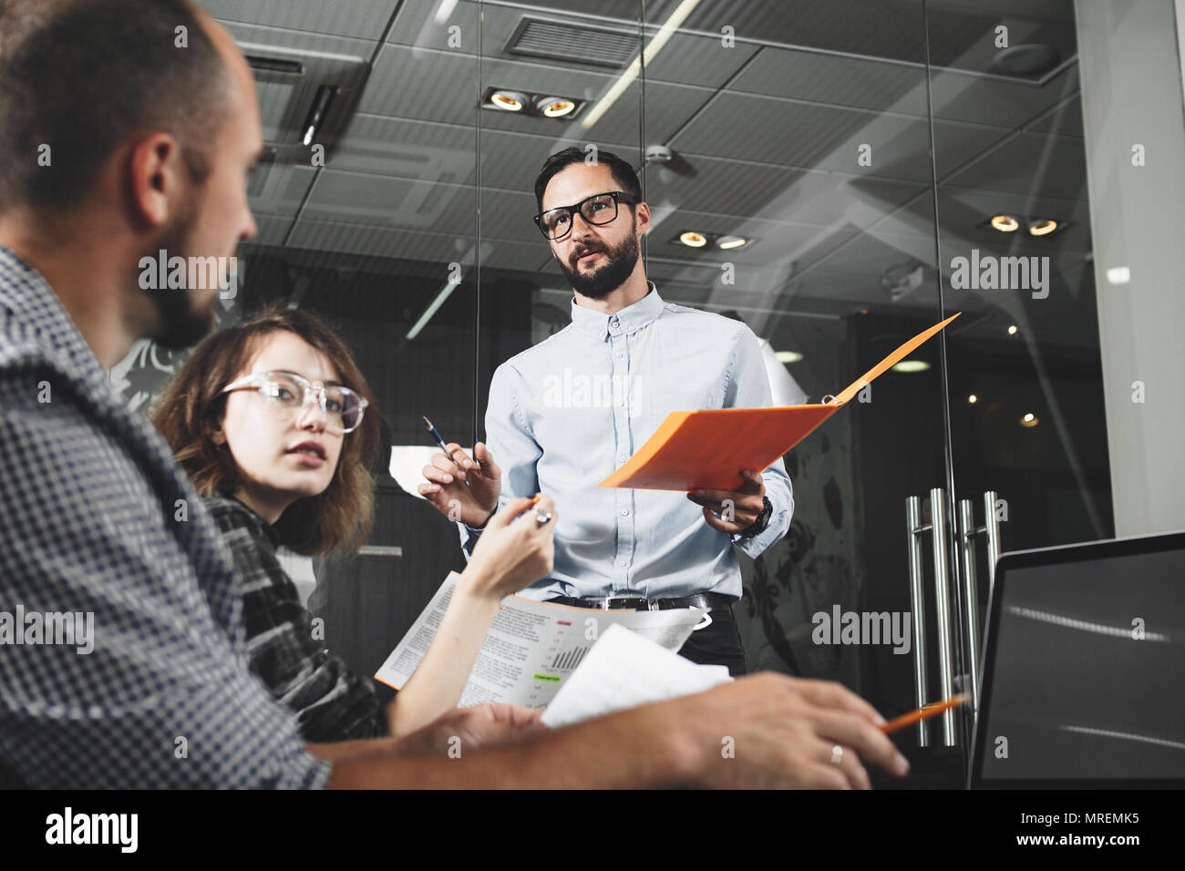 Account manager works with clients in loft office. Training staff. Teamwork and brainstorming - Stock Image