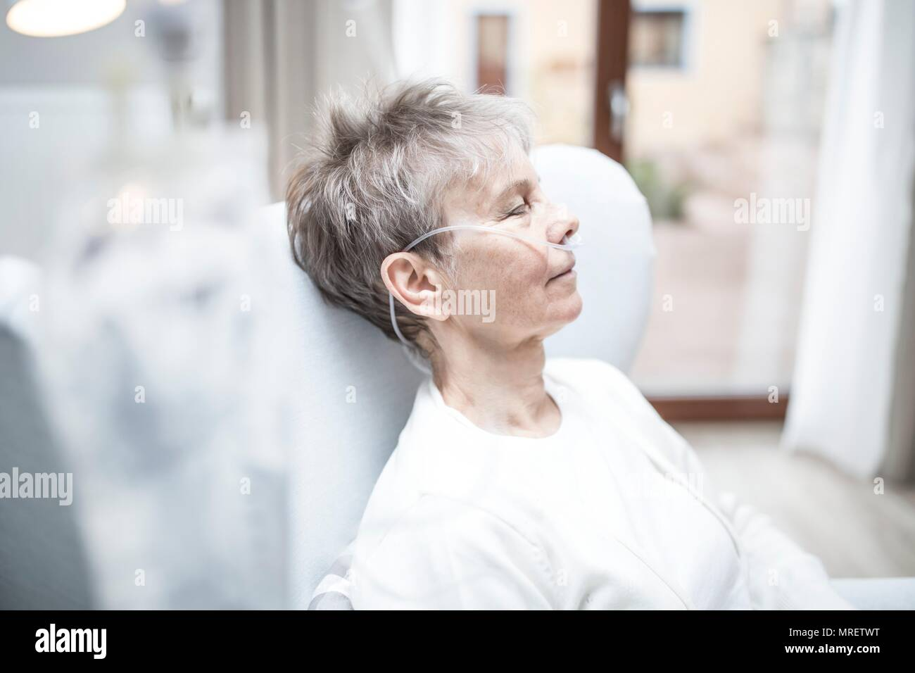 Senior woman with nasal cannula. Stock Photo