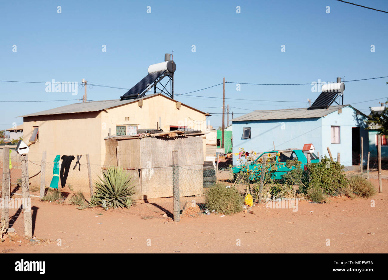 House on an informal settlement (township) with a solar water heater, Vredendal, Western Cape, South Africa. - Stock Image
