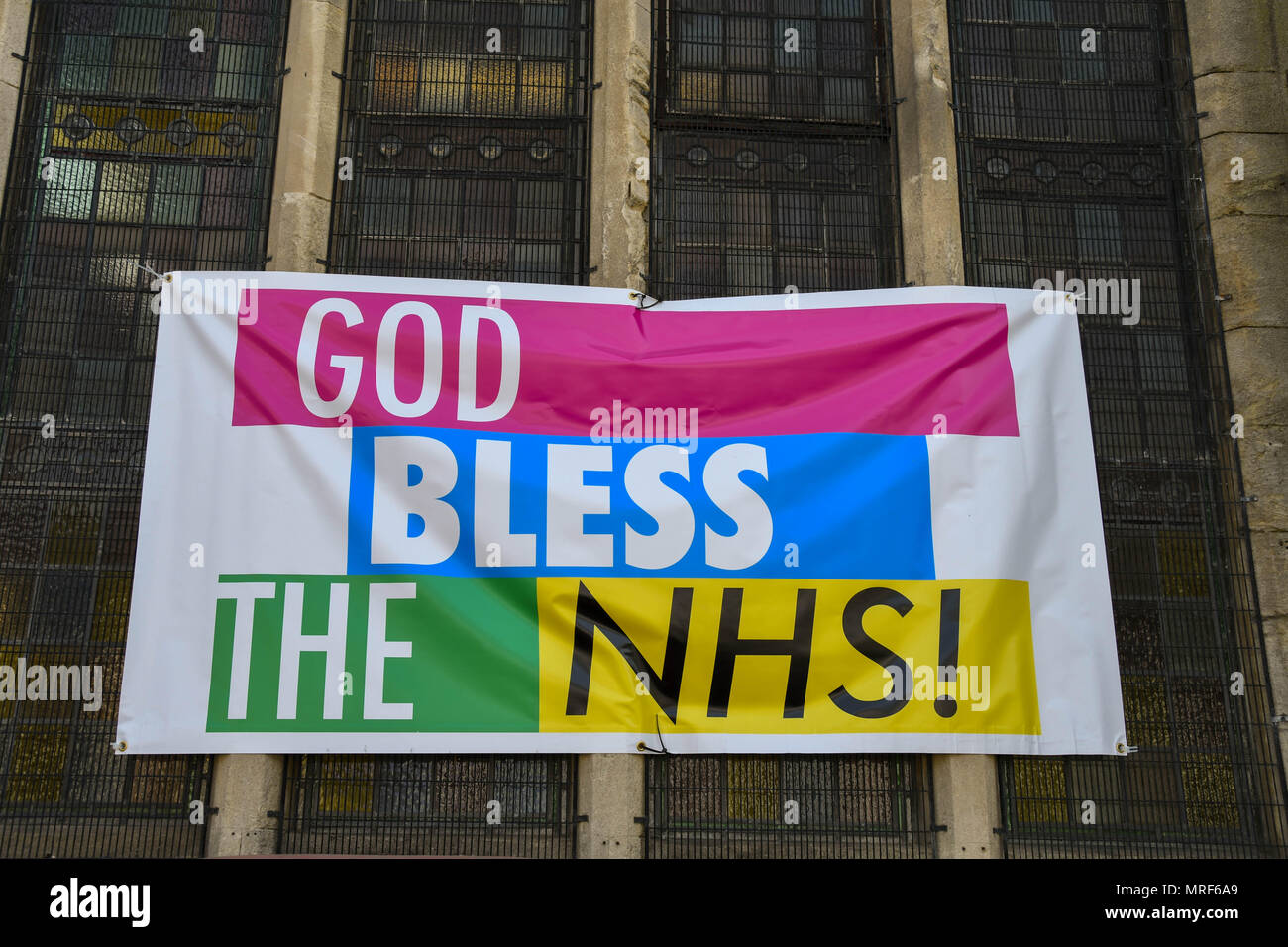 Colourful banner supporting the National Health Service attached to the side of a church hall in Pontypridd town centre Stock Photo