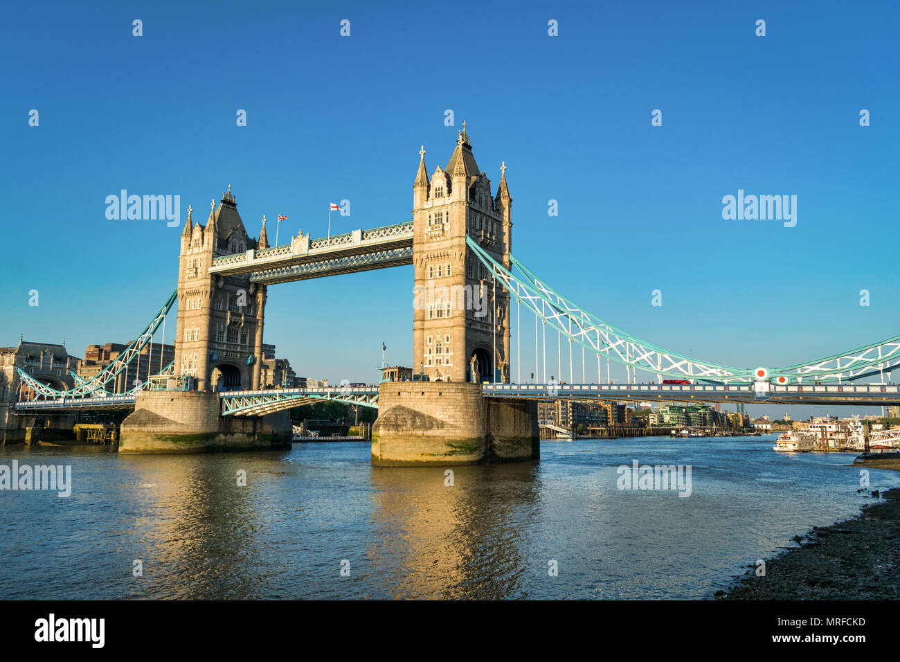 The Iconic Tower Bridge in London spanning the Thames River - Stock Image