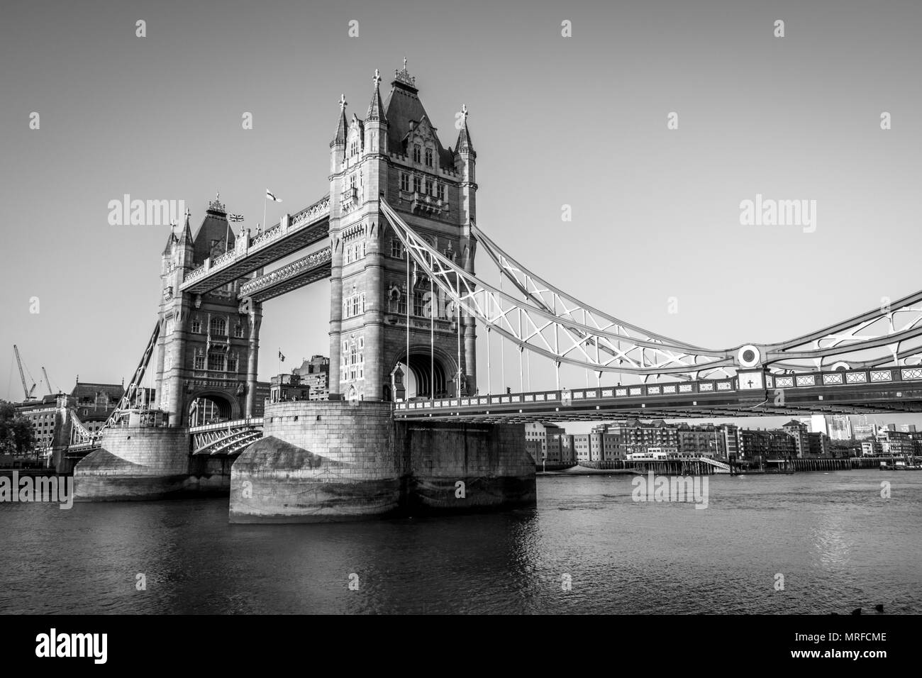 This is an black and white photograph of Londons Icon Tower Bridge. - Stock Image