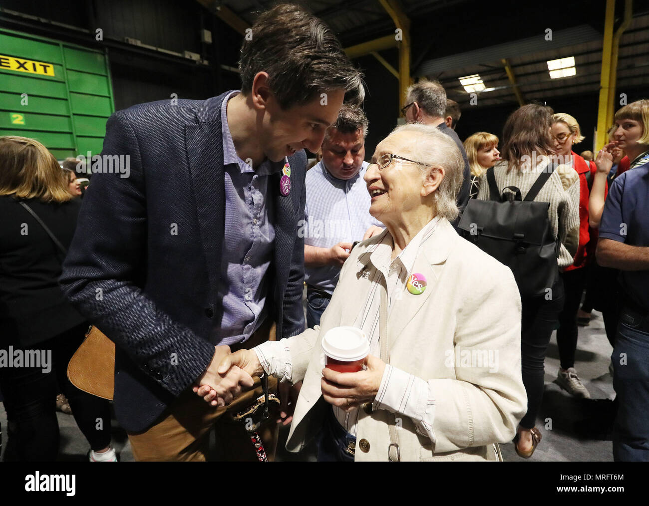 Minister for Health Simon Harris is greeted by retired Supreme Court judge Catherine McGuinness on arrival at the count centre in Dublin's RDS as votes are counted in the referendum on the 8th Amendment of the Irish Constitution which prohibits abortions unless a mother's life is in danger. Picture date: Saturday May 26, 2018. See PA story IRISH Abortion. Photo credit should read: Brian Lawless/PA Wire - Stock Image