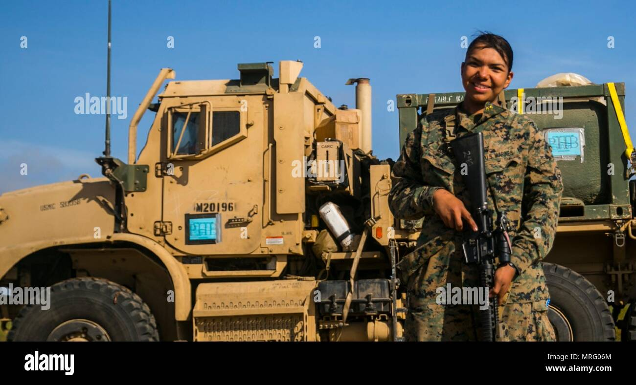 MARINE CORPS BASE CAMP PENDLETON, Calif. – Cpl. Alicia Lozano, a motor transport operator with the 15th Marine Expeditionary Unit's Logistics Combat Element, poses in front of her designated truck during Certification Exercise, June 7, 2017. Lozano joined the Marine Corps following her uncle's steps, who served 20 years as a Motor-T operator. (U.S. Marine Corps photo by Cpl. F. Cordoba) Stock Photo
