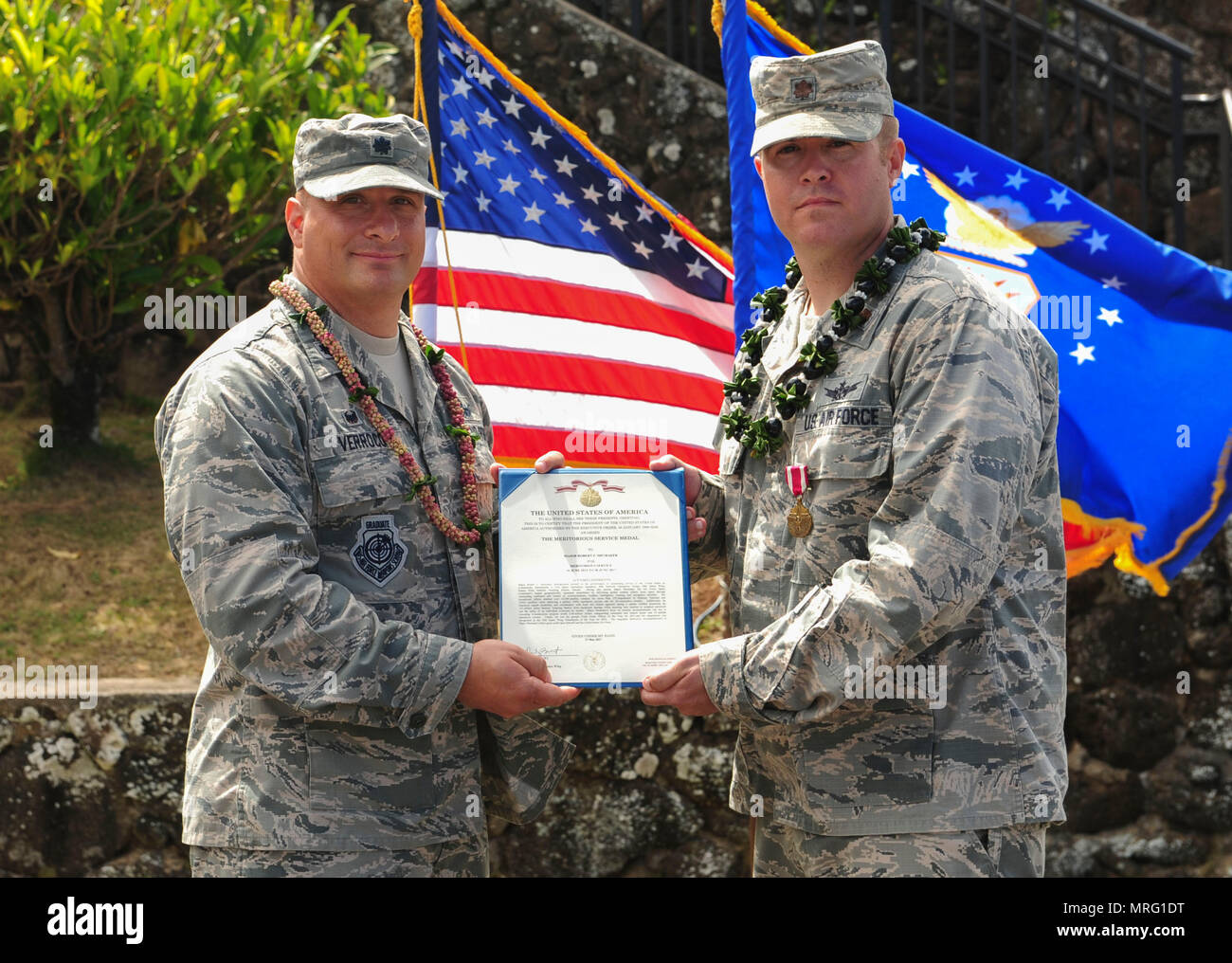 Lt. Col. Phillip Verroco, 21st Space Operations Squadron commander, presents Maj. Robert F. Shumaker, Detachment 3 outgoing commander, with the Meritorious Service Medal during the Detachment 3 Change of Command Ceremony, Kaena Point, Hawaii, June 9, 2017.  Detachment 3 is a component of the 21st Space Operations Squadron, 50th Network Operations Group, 50th Space Wing, and is located on the western tip of Oahu.  It is the oldest and one of seven worldwide remote tracking stations in the Air Force Satellite Control Network.  (U.S. Air Force photo by Tech. Sgt. Heather Redman) - Stock Image
