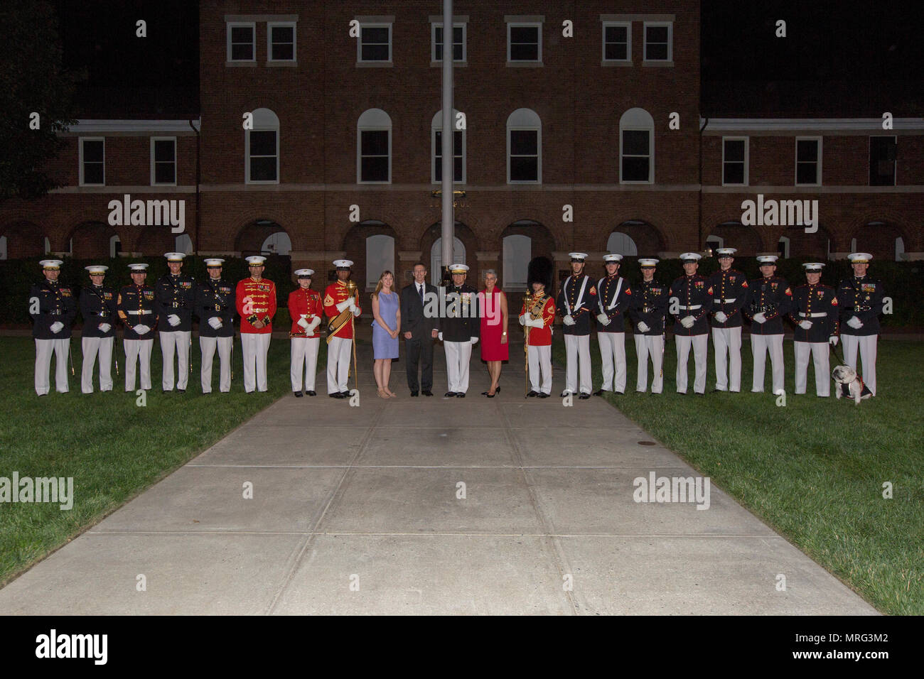 Secretary of the Navy the Honorable Sean J. Stackley, center left, and the Commandant of the Marine Corps Gen. Robert B. Neller, center right, pose for a photo with U.S. Marines from Marine Barracks Washington following an evening parade at Marine Barracks Washington, Washington, D.C., June 9, 2017. Evening parades are held as a means of honoring senior officials, distinguished citizens and supporters of the Marine Corps. (U.S. Marine Corps photo by Cpl. Christian Varney) Stock Photo