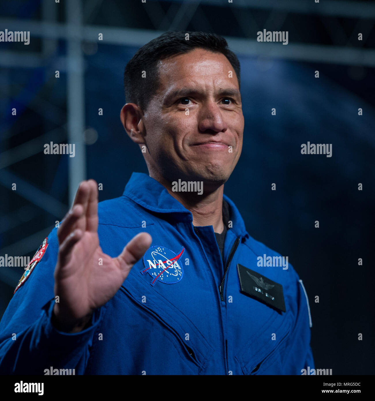 41-year-old NASA astronaut candidate Francisco Rubio waves as he is introduced as one of 12 new candidates, Wednesday, June 7, 2017 during an event at NASA's Johnson Space Center in Houston, Texas. After completing two years of training, the new astronaut candidates could be assigned to missions performing research on the International Space Station, launching from American soil on spacecraft built by commercial companies, and launching on deep space missions on NASA's new Orion spacecraft and Space Launch System rocket. Photo Credit: (NASA/Bill Ingalls) - Stock Image