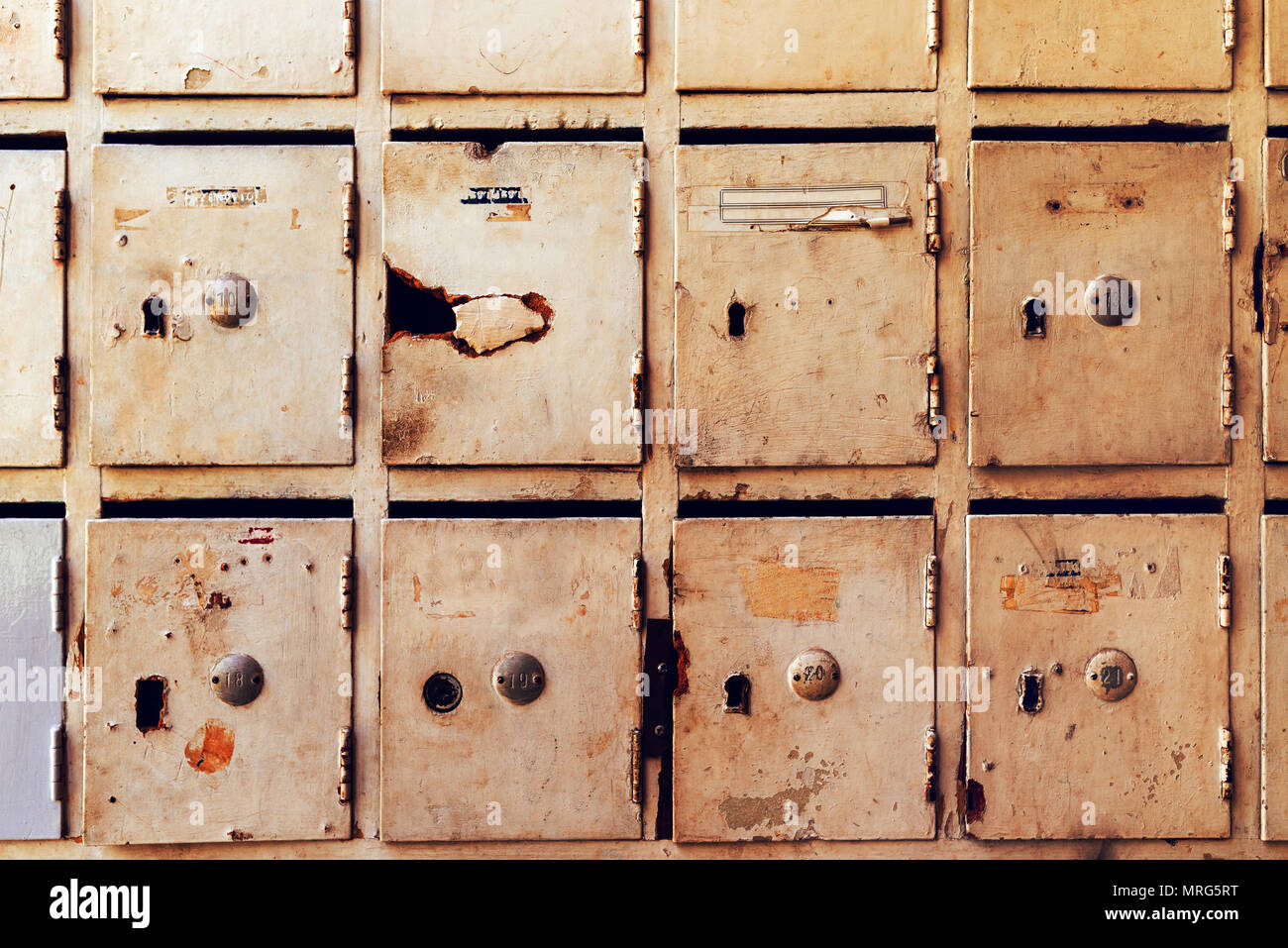 Obsolete mailboxes for post and letters inside of an old apartment ...