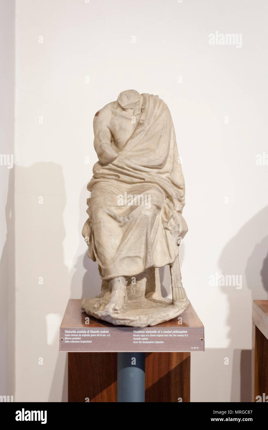 Headless statue of a seated philosopher - Stock Image