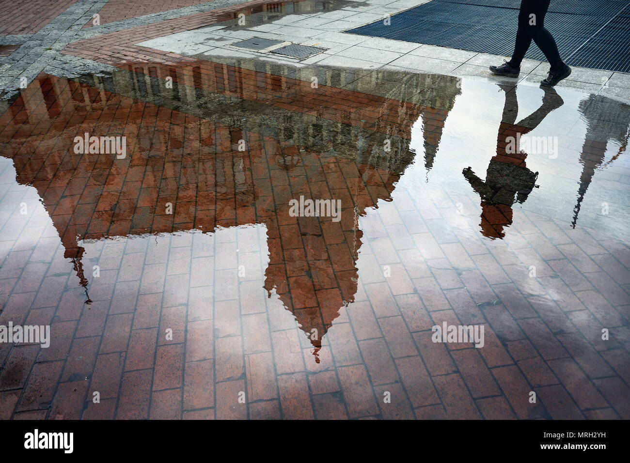 Woman reflection in puddle at Europe Square in Batumi - Stock Image