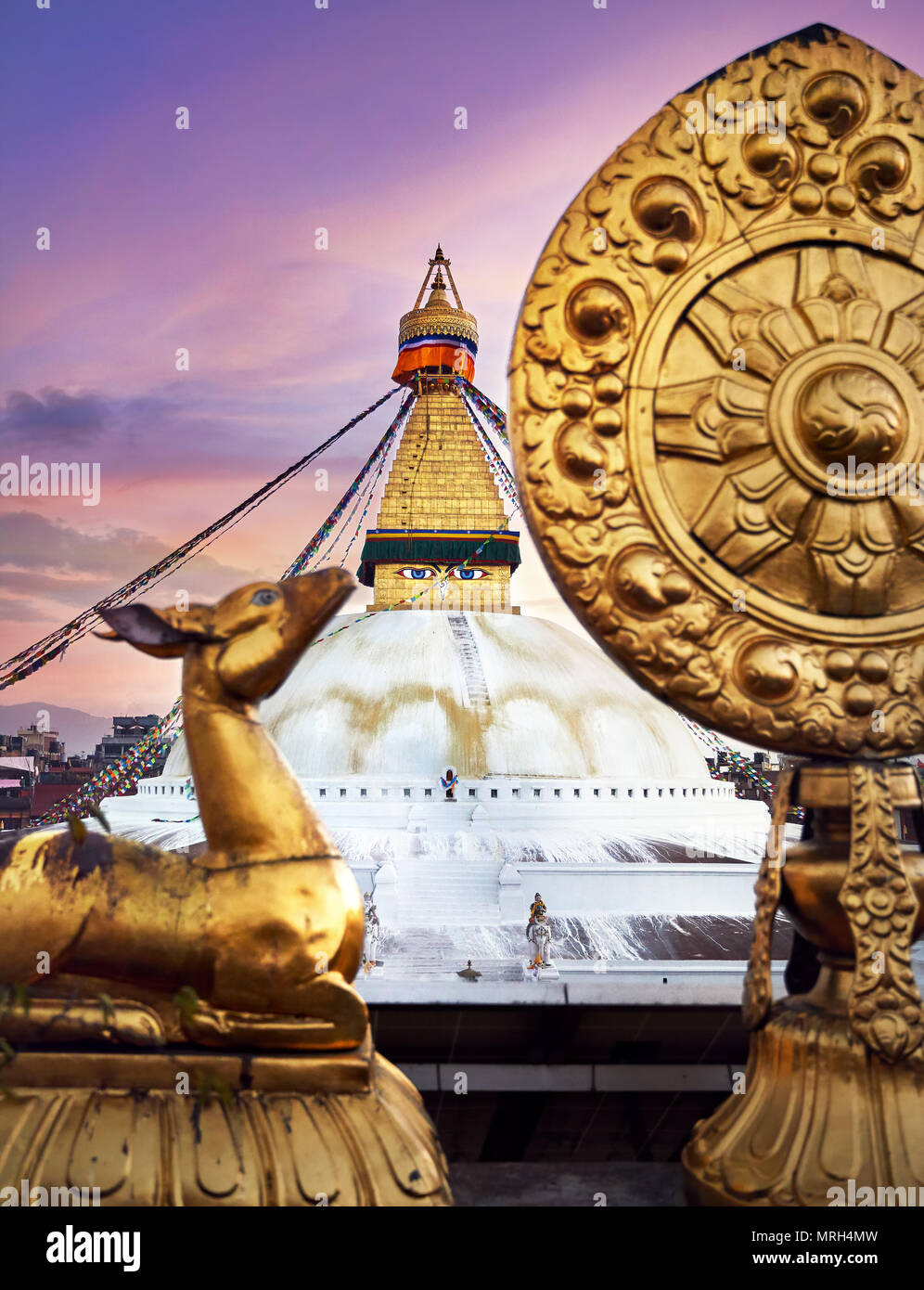 View of Bodnath Buddhist Stupa and Golden deers with leaf at the roof of monastery in Kathmandu - Stock Image