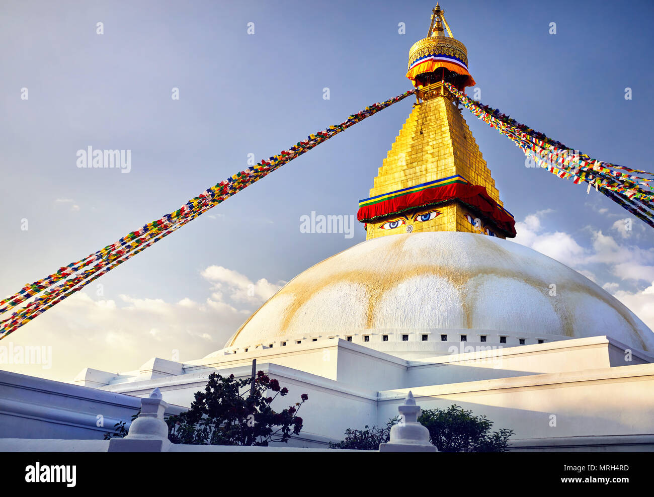 Bodnath Great Buddhist Stupa with prayer flags in Kathmandu - Stock Image