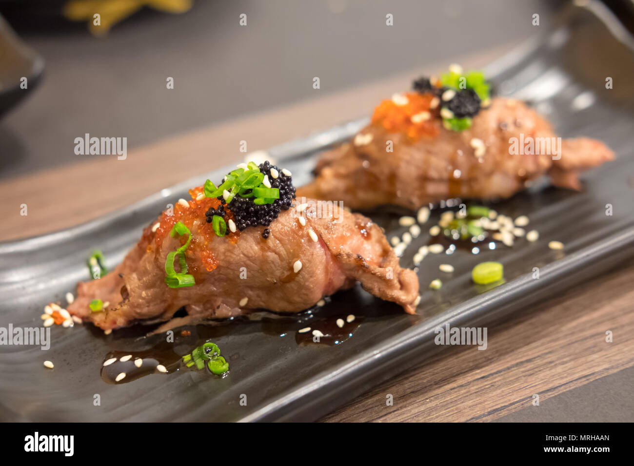 Set of grilled wagyu beef sushi with flying fish roe or for Flying fish roe