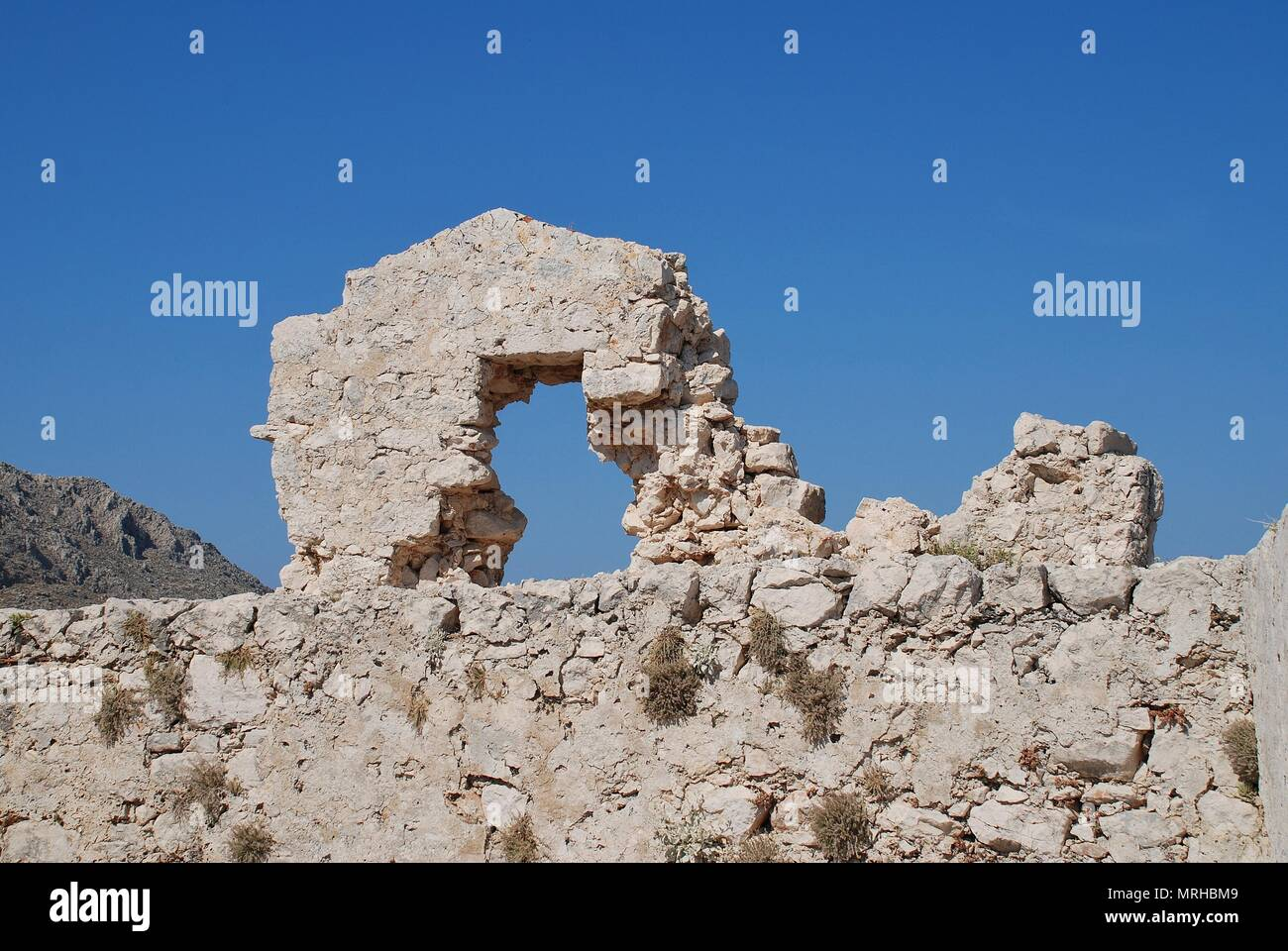 The ruins of the medieval Crusader Knights castle on the Greek island of Halki. - Stock Image