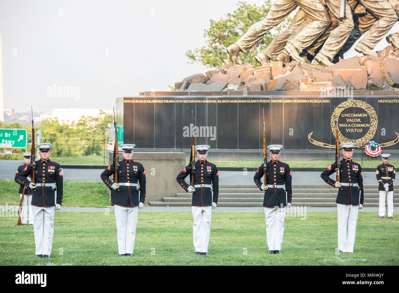 The U.S. Marine Corps Silent Drill Platoon performs during a sunset parade at the Marine Corps War Memorial, Arlington, Va., June 13, 2017. Sunset parades are held as a means of honoring senior officials, distinguished citizens and supporters of the Marine Corps. (U.S. Marine Corps photo by Lance Cpl. Hailey D. Clay) Stock Photo