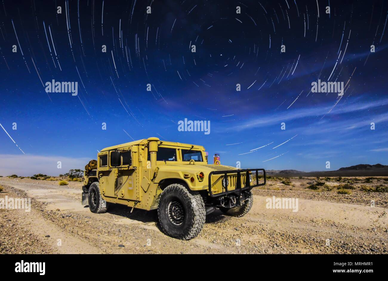 A 99th Civil Engineer Squadron explosive ordnance disposal team Humvee sits under the stars during a training exercise at the Nevada Test and Training Range June 7, 2017. The Humvee is the military's premier light armored truck and has multiple modifications that best suits each unit's specific needs. (U.S. Air Force photo illustration by Airman 1st Class Andrew D. Sarver/Released) Stock Photo