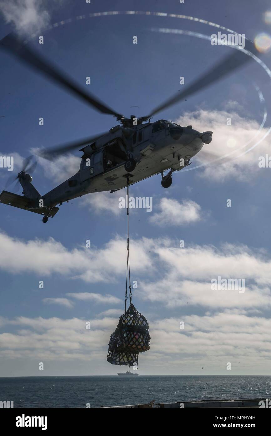 Pacific Ocean An Mh 60 Seahawk Lowers Supplies Onto The Flight