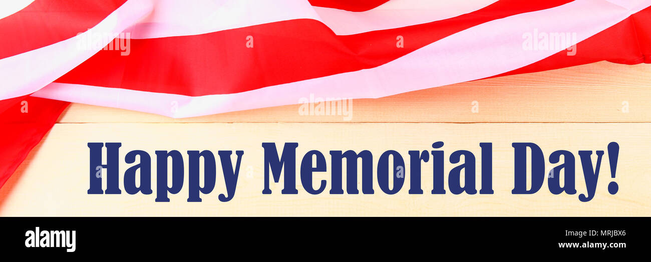 USA Memorial Day concept with calendar and red remembrance poppy on American stars and stripes flag Stock Photo