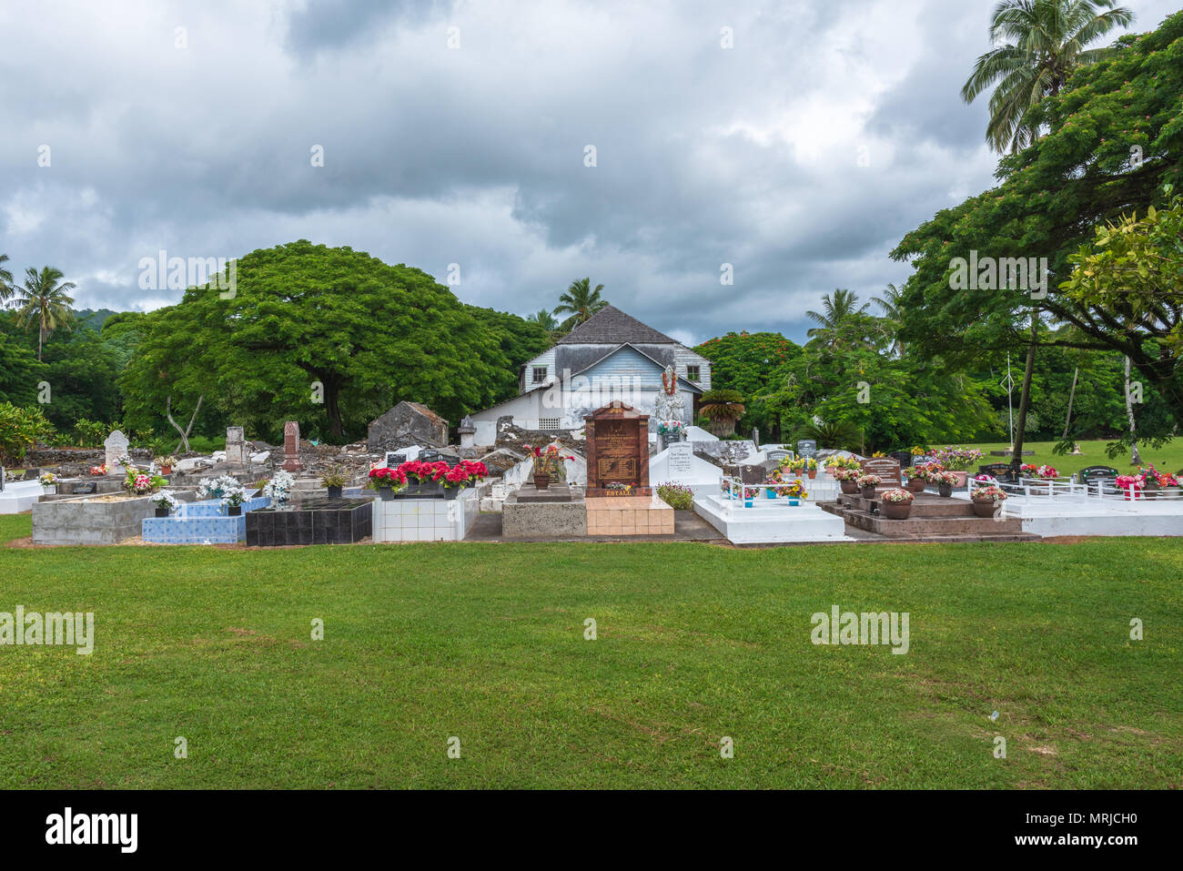 Rarotonga, Cook Islands--March 13, 2018. A cemetery in Raratonga; Carefully tended cemeteries and gravestones are an important part of the local cultu - Stock Image