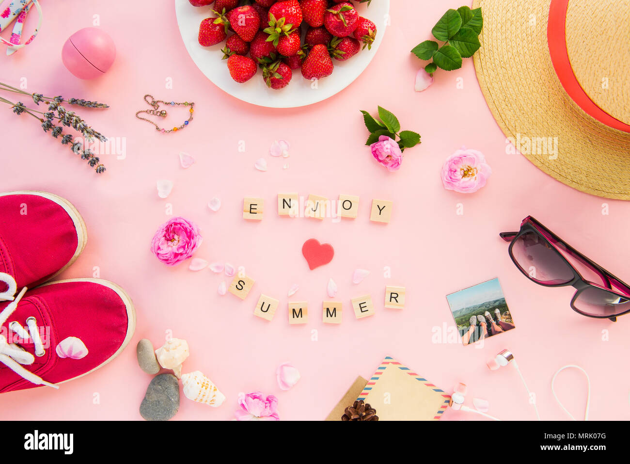 Female summer vacation planning concept accessories clothing female summer vacation planning concept accessories clothing flowers and strawberries on pink background enjoy summer lettering bright mood deta mightylinksfo