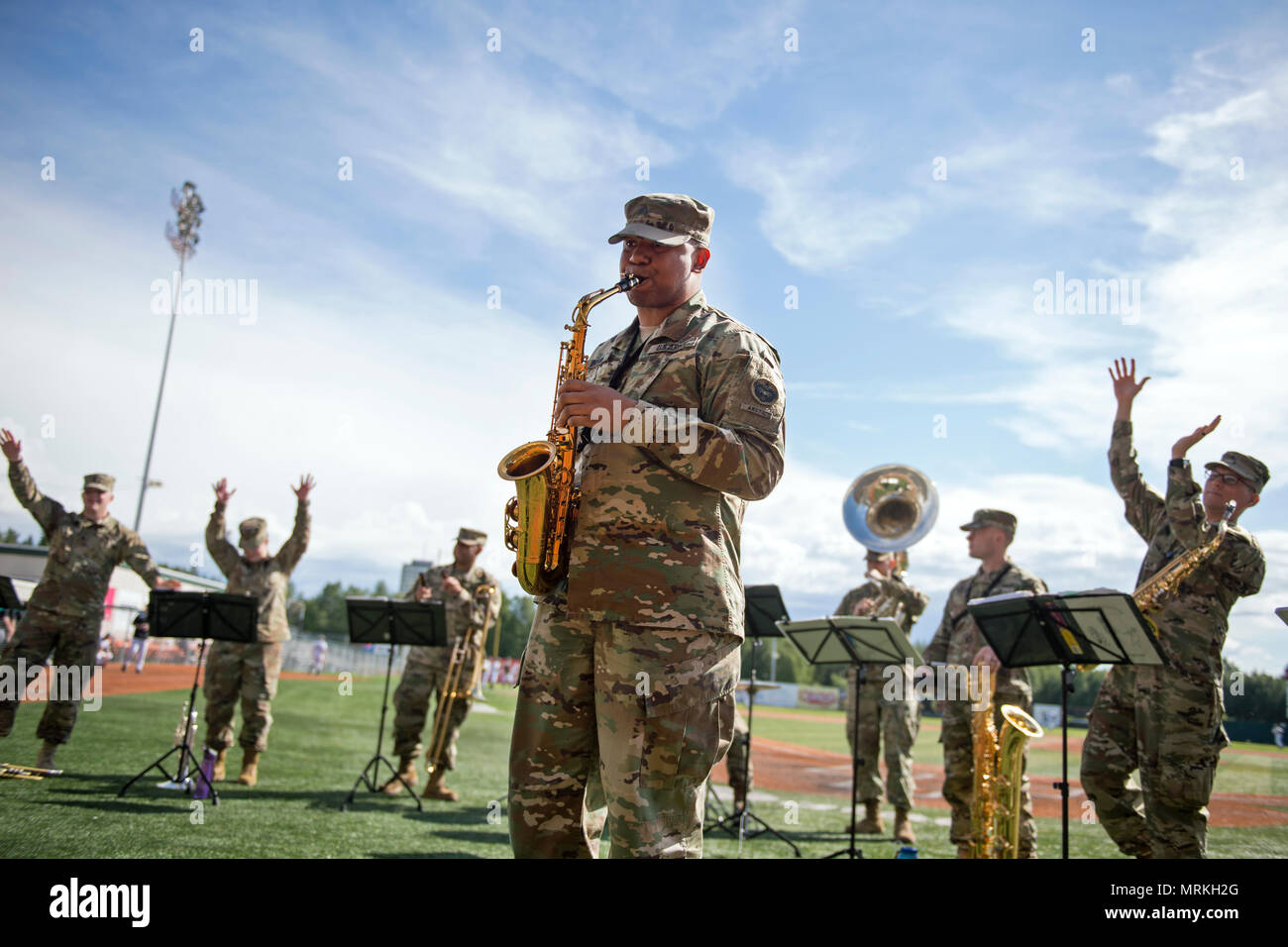 U.S. Army Alaska's 9th Army Band serenades Anchorage area baseball fans at Mulcahy Stadium in Anchorage, Alaska, June 16, 2017. The Anchorage Bucs faced off against the Peninsula Oilers for a doubleheader as part of a military appreciation event. (U.S. Air Force photo by Airman 1st Class Javier Alvarez) - Stock Image