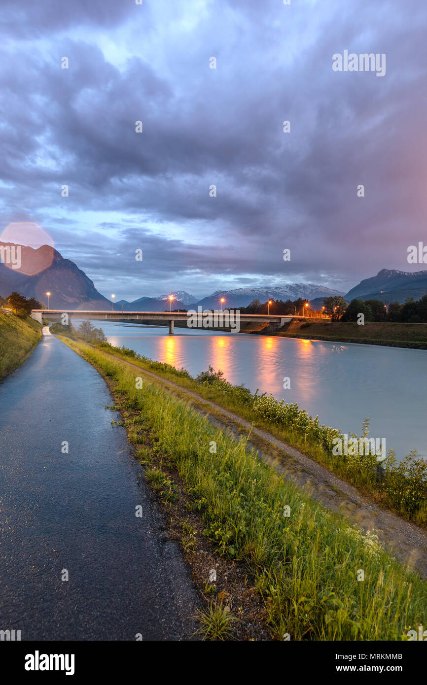 Dramatic sky in the mountains. Bridge across the Rhine. Stock Photo