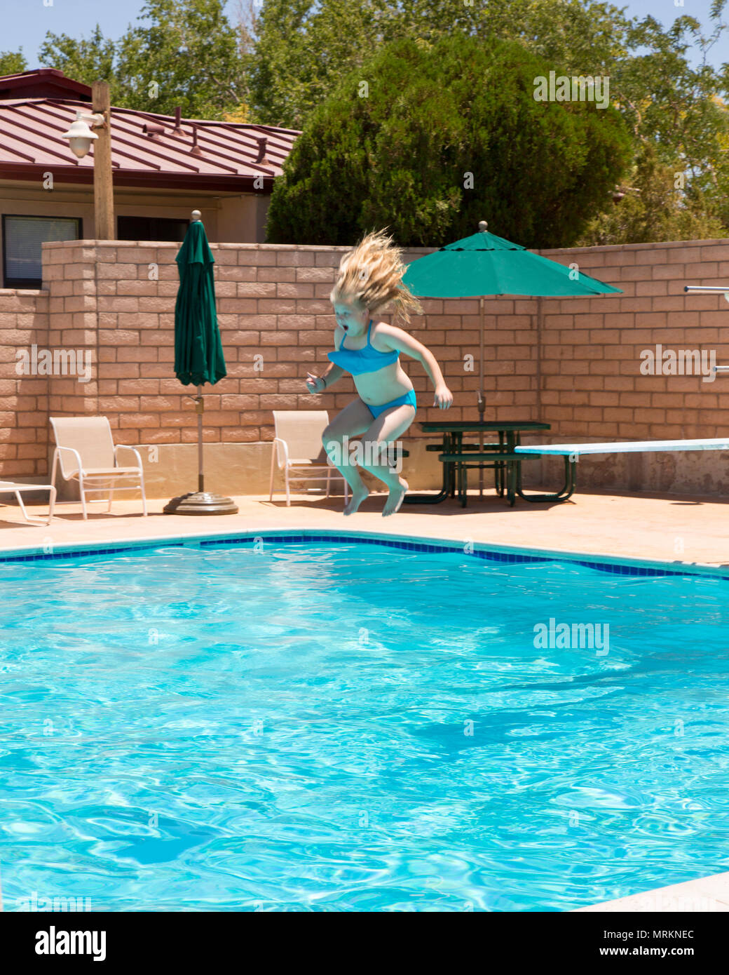 5f74391fd44 Chloe Bledsoe takes a plunge off the diving board at the Oasis Pool and  Water Park during the School Age Care Summer Camp held aboard Marine Corps  Logistics ...