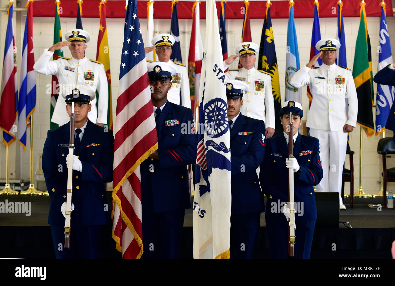 The color guard presents the colors at the Coast Guard Seventh District Change of Command Ceremony at Air Station Miami on June 23, 2017. Coast Guard Rear Adm. Peter J. Brown relieved Rear Adm. Scott A. Buschman as commander of the Seventh District. Stock Photo