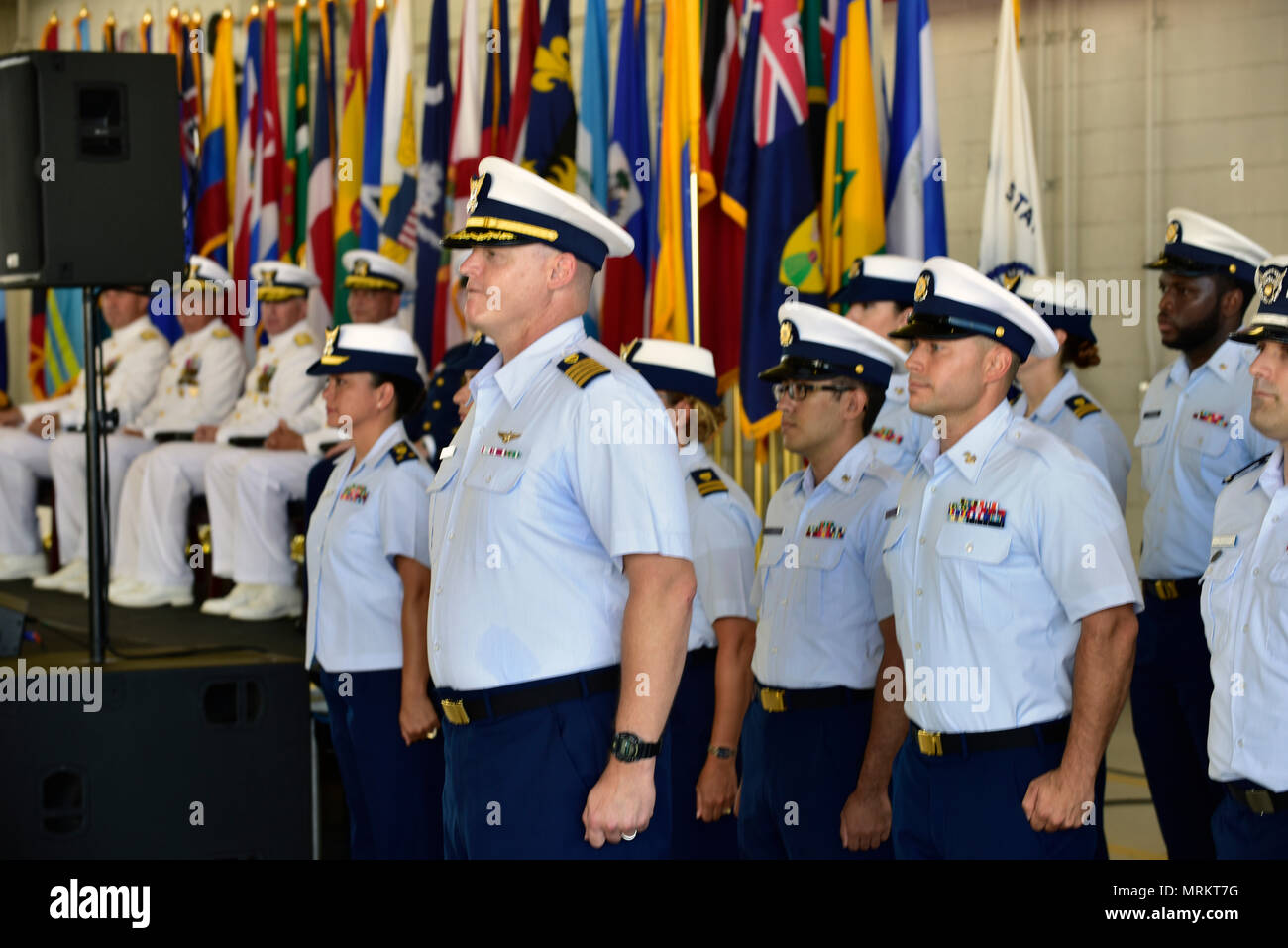 The Coast Guard Seventh District crew stands at attention during their Change of Command Ceremony at Air Station Miami on June 23, 2017. Coast Guard Rear Adm. Peter J. Brown relieved Rear Adm. Scott A. Buschman as commander of the Seventh District. Stock Photo