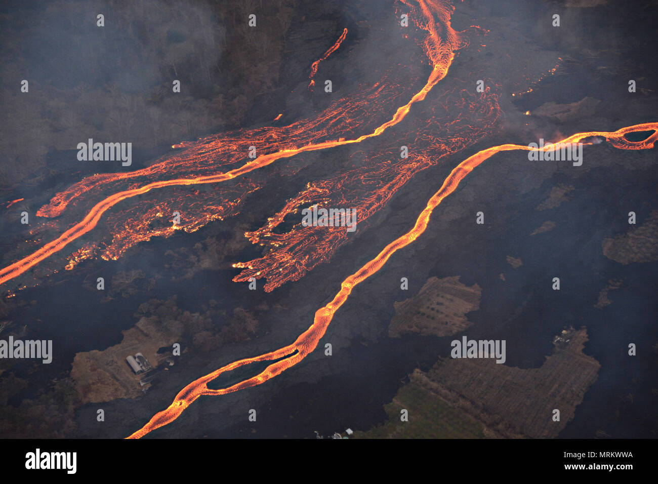 Channelized lava streams down the East Rift Zone from the eruption of the Kilauea volcano May 23, 2018 in Pahoa, Hawaii. Stock Photo