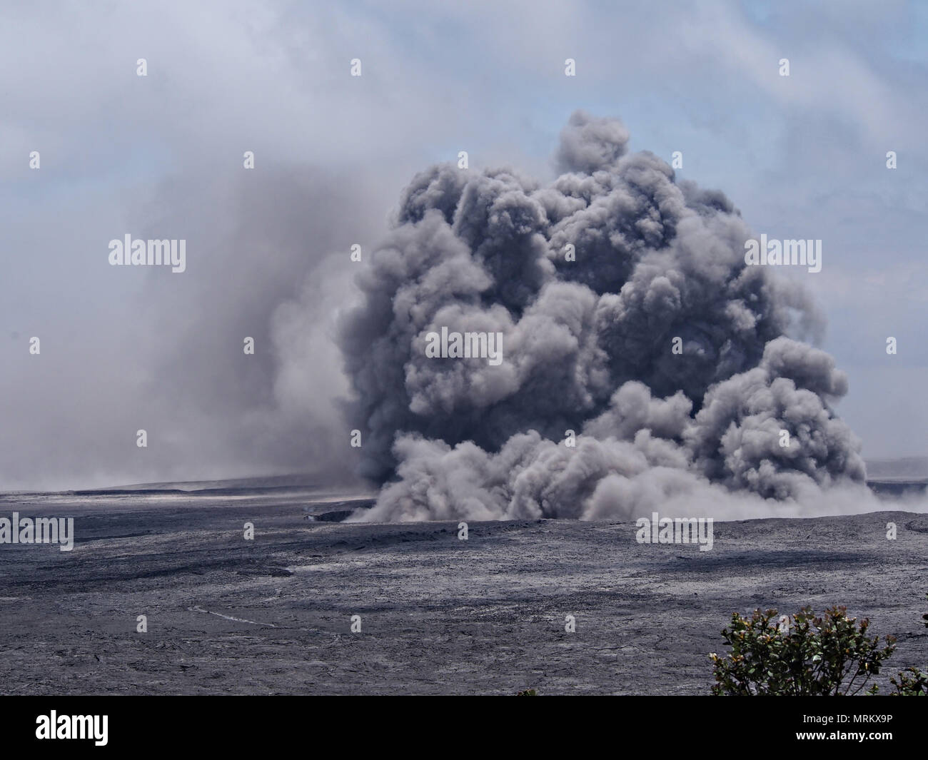 An ash plumes rises thousands of feet at the summit of the Kilauea volcano May 23, 2018 in Pahoa, Hawaii. Stock Photo