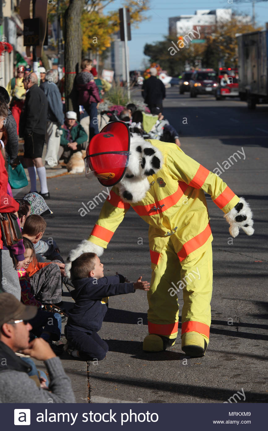 A man dressed as sparky the firedog greets children during the a man dressed as sparky the firedog greets children during the thanksgiving day parade in waterloo ontario canada thanksgiving day is a national m4hsunfo